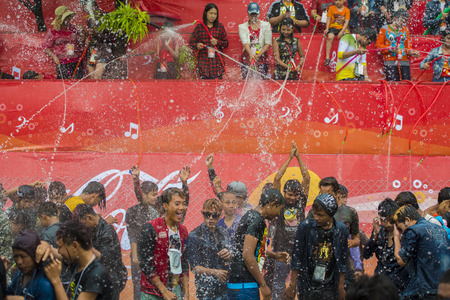 People at the Waterparty at the Thingyan Water Festival at the Myanmar New Year in the city centre of Mandalay in Manamar in Southeastasia.