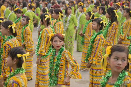 Traditional Dance Girls at the Thingyan Water Festival at the Myanmar New Year in the city centre of Mandalay in Manamar in Southeastasia.