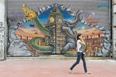 streetlife: a painting on a Door in Banglaphu in the city of Bangkok in Thailand in Southeastasia.