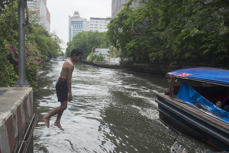 durty: Childern play in the Khlong saen saeb at Pratunam in the city of Bangkok in Thailand in Southeastasia.