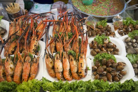 aerea: Seafood at a streetmarket at the charoen Krung road at the Riverside Aerea in the city of Bangkok in Thailand in Southeastasia. Stock Photo