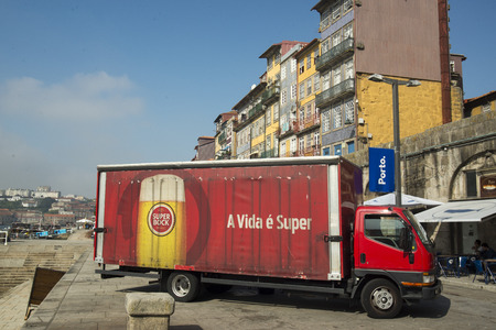 ribeira: a beer transport  of sagres in Ribeira in the city centre of Porto in Porugal in Europe. Editorial