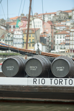ribeira: the port wine Boats at the waterfront with the old town on the Douro River in Ribeira in the city centre of Porto in Porugal in Europe. Editorial