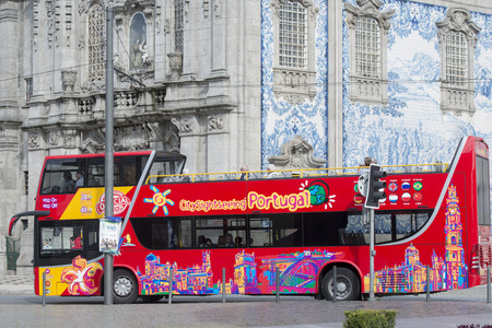 ribeira: a tourist bus in Ribeira in Ribeira in the city centre of Porto in Porugal in Europe. Editorial