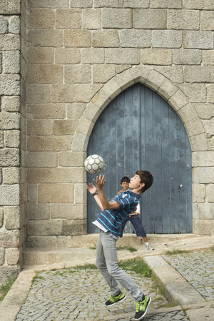 se: boys plas street soccer near the cathedral se in ribeira in the city centre of Porto in Porugal in Europe. Editorial