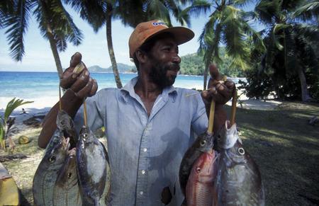 afrika: a fishingmen on the Island Praslin of the seychelles islands in the indian ocean