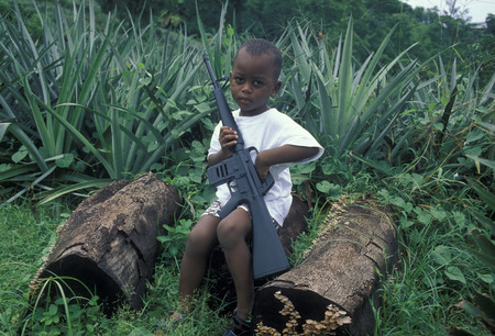 a child security at a Pinaple Plantation with a Gun the Island Praslin of the seychelles islands in the indian ocean Editorial