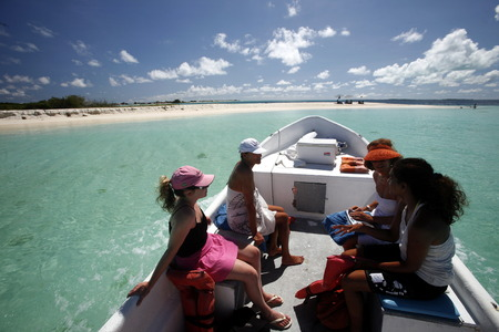 southamerica: a boat tour near the village on the Gran Roque Island at the Los Roques Islands in the caribbean sea of Venezuela. Editorial