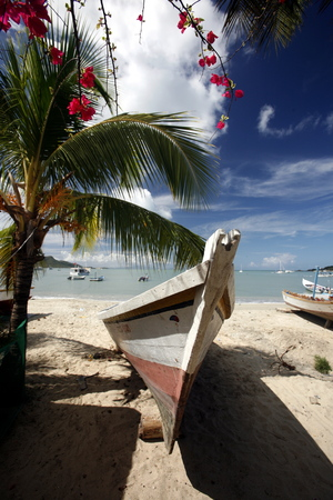 isla: fishingboat at the beach in the town of Juangriego on the Isla Margarita in the caribbean sea of Venezuela. Stock Photo