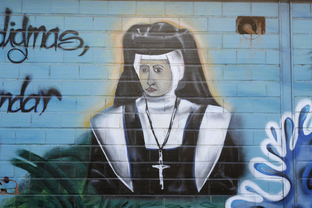 southamerica: a pictures of a nun in a road in the town of choroni near choroni on the caribbean coast in Venezuela.