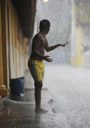 southamerica: childern play by rain in the town of chuao near choroni on the caribbean coast in Venezuela.