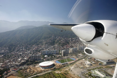 caracas: a airplane landing at the Caracas Airport at the coast of Caracas in the north of Venezuela. Editorial