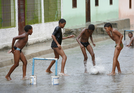 southamerica: childern play soccer by rain in the town of chuao near choroni on the caribbean coast in Venezuela.