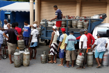 southamerica: people buy Gas at the market the village of choroni on the caribbean coast in Venezuela.