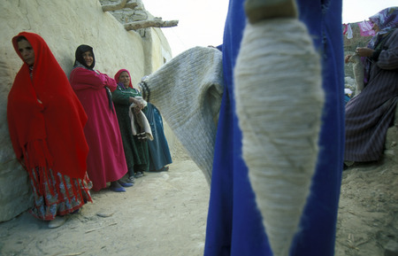 north africa: people in the town and Oasis of Farafra in the lybian or western desert of Egypt in north africa