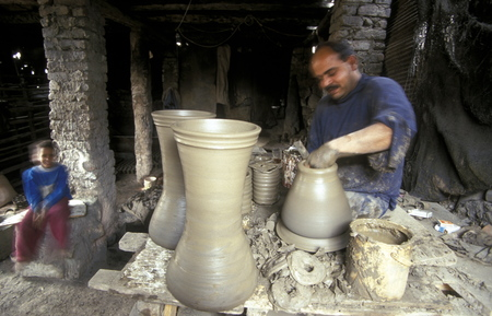 north africa: workers in a pottery factory in the old town of Cairo the capital of Egypt in north africa