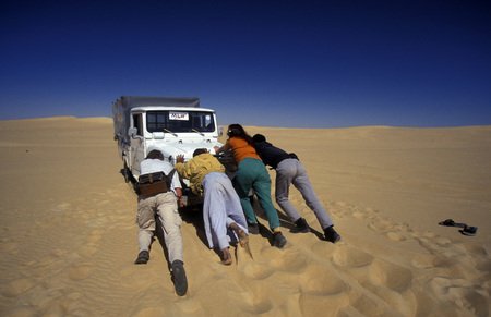 north africa: a car defect in the sanddunes near the Oasis and village of Siwa in the lybian or western desert of Egypt in north africa