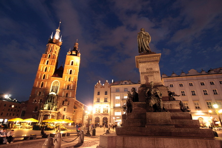 rynek: the Rynek Glowny square with the church of St Mary in the old town of Cracow in Poland in east Europe.