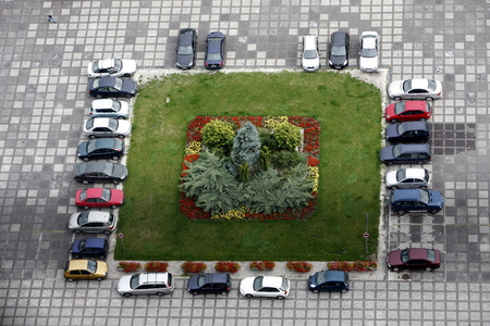 east europe: a car parking in the City of Warsaw in Poland, East Europe.