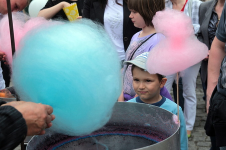 suger: people at a family fair in the old town of Poznan in Poland in east Europe. Editorial