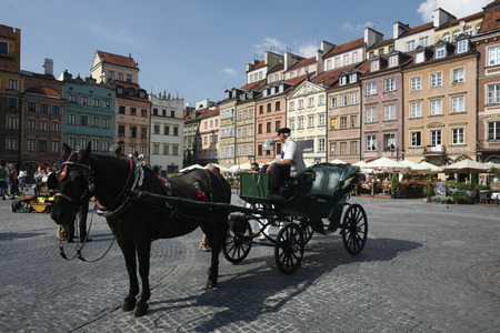 east europe: the marketsquare the old town in the City of Warsaw in Poland, East Europe. Editorial