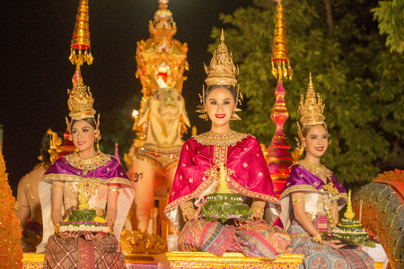 tradition: traditional dresst people at the night parade at the Loy Krathong Festival in the city of Chiang Mai in North Thailand in Thailand in southeastasia.