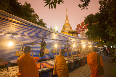 a nightmarket at a Wat in the old town of Chiang Mai in North Thailand in Thailand in southeastasia.