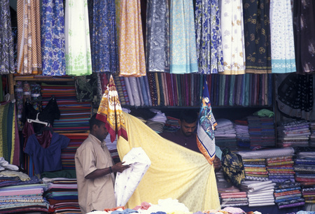 textil: a textil shop at the market in the town of Hikkaduwa in the southwest of Sri Lanka in Asien.