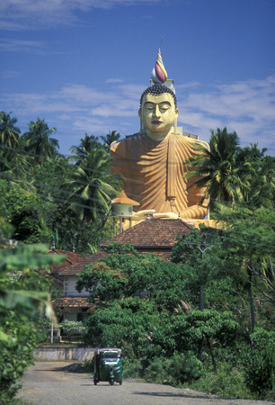 buddha sri lanka: the Big Buddha at the Weherahena Temple in the south of Sri Lanka in Asien.