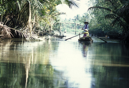 a smal wood Boat on the Mekong River near the city of Can Tho in the Mekong Delta in Vietnam
