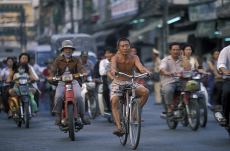 velo: people on the bicycle in the city of ho chi minh city in Vietnam