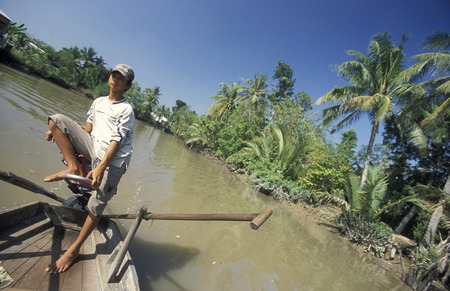 mekong river: a smal wood Boat on the Mekong River near the city of Can Tho in the Mekong Delta in Vietnam