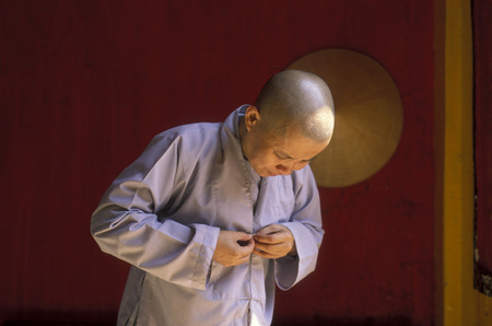 can tho: a women monk in a chinese temple in the city of Can Tho in the mekong delta in Vietnam Editorial