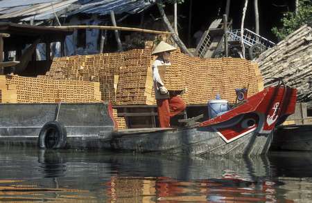 can tho: a Transport Boat on the Mekong River near the city of Can Tho in the Mekong Delta in Vietnam