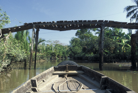 smal: a smal wood Boat on the Mekong River near the city of Can Tho in the Mekong Delta in Vietnam