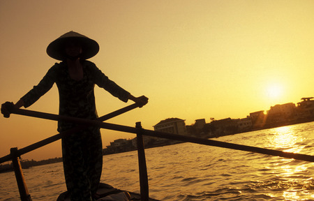 can tho: a smal wood Boat on the Mekong River near the city of Can Tho in the Mekong Delta in Vietnam