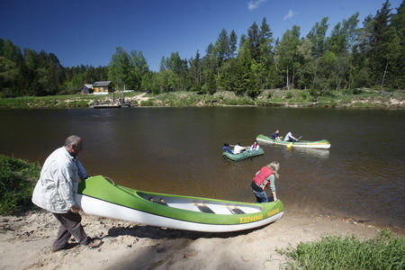 gauja: people on a canue trip on the gauja river near the town of sigulda near city of riga in latvia in the baltic region in europe.