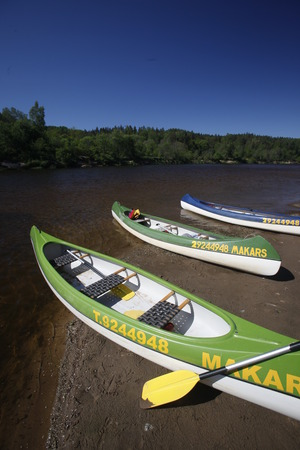 baltic people: people on a canue trip on the gauja river near the town of sigulda near city of riga in latvia in the baltic region in europe.