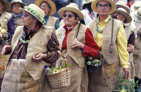 portugal agriculture: people at the onion festival near Camacha on the Island of Madeira in the Atlantic Ocean of Portugal.