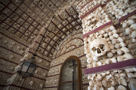 the capela dos ossos at the Igreja do Carmo in the old town of Faro at the east Algarve in the south of Portugal in Europe. Editorial