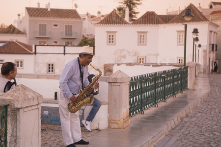 romana: streetmusic on the Bridge Ponte Romana in the old town of Tavira at the east Algarve in the south of Portugal in Europe.