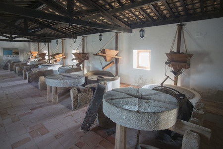 water mill: the water mill the natural Park of Quinta de marim of Ria Formosa near the Town of Olhao at the east Algarve in the south of Portugal in Europe.