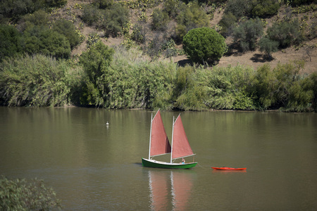 sailing boats: the river Rio Guadiana on the Border of portugal and Spain neat the town of Alcoutim at the east Algarve in the south of Portugal in Europe.