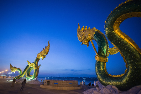 mekong river: a Phayanak or Naga Statue at the mekong river in the town of Nong Khai in Isan in north east Thailand