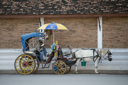 hackney carriage: a horse carriage at the Wat Prathat Lampang Luang near of the city of Lampang in North Thailand. Editorial