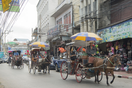 hackney carriage: horse carriage in the old town of the city of Lampang in North Thailand.
