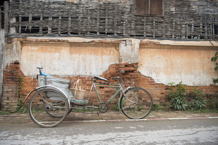 a old bicycle in the old town of Chiang Khan in Isan in north east Thailand