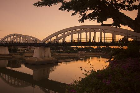 wang: the ratsadapisek bridge of the world war 2 at the wang river in the city of Lampang in North Thailand. Stock Photo