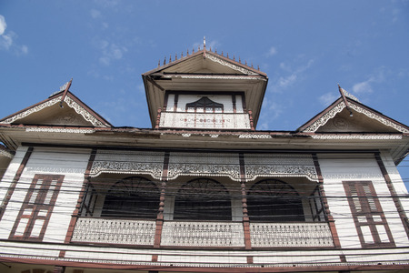sin city: the old woodhouse Mong Ngoauy Sin Building in the old town of the city of Lampang in North Thailand.