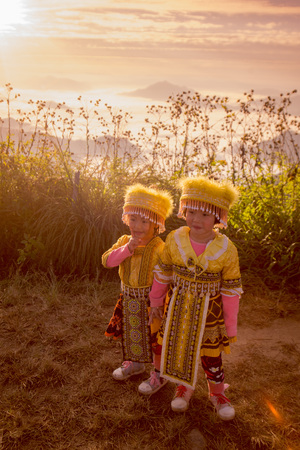 fa: childern of the Hill Tribe of Hmong enjoy at the Cliff of Phu Chi Fa in the Chiang Rai Province in North Thailand. Editorial